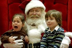 Crying kids might not be the only problem for mall Santas this year. As 22-month-old Mia Castaneda lets her feelings be heard and seen on a visit to Santa in 2007.