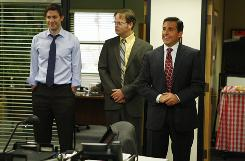 "Rainn Wilson, center, plays the brown-nosing Dwight in NBC's ""The Office."" Also in the cast: Steve Carell, right, as the boss and John Krasinski, a co-worker."