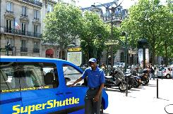 SuperShuttle driver Elie Tambou works for the airport shuttle service, which has launched in Paris.