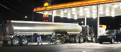 A tanker truck makes a fuel delivery at a Little Rock gas station. Oil prices rose above $78 a barrel on Monday, Nov. 23, 2009.