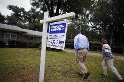 Daniel and Robin Akerman into their new house after buying in short sale in Pensacola, Fla.., in November.