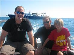 Sean, Kim and Ricky Fisher on the back of the survey vessel Huntress.