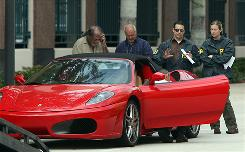 Federal agents seized many of Scott Rothstein's assets, including this 2006 Ferrari Spider convertible.