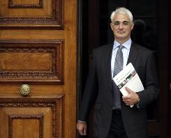 Britain's Chancellor of the Exchequer Alistair Darling leaves the Treasury in London, to deliver a budget report,