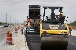 Road construction crews work on a project run by the Florida Department of Transportation on Feb. 18, in Florida City. The project used funds from the stimulus bill.
