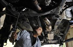 "Ted Perez inspects a vehicle at H & R Auto Service in Kennett Square, Pa. Shop owner Hal Lewis says that in addition to ensuring safety, inspections ""save people a lot of grief, breakdowns and unexpected expenses."""