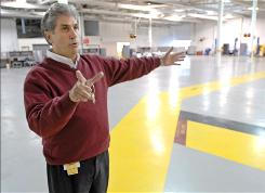 "Great Lakes Technology Centre property manager Joseph Caleca gives a tour of of the building in Flint, Mich. ""We're hoping to bring in a user and not an investor, to bring jobs to Flint"" said Caleca."