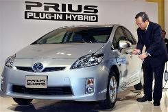 "Toyota  Executive Vice President Takeshi Uchiyamada demonstrates the company's""Prius Plug-in Hybrid"" in Tokyo, Monday."