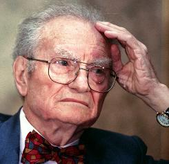 "Nobel laureate Paul Samuelson listens to remarks during a program on Jan. 4, 1998, in Chicago that marked the 50th year and the 16th edition of his book ""Economics."""