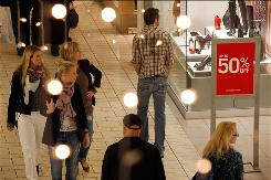 Shoppers search for holiday sales at the Beverly Center Dec. 11, in Los Angeles.