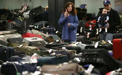 Fliers search for their bags last December at Seattle-Tacoma International Airport in Seattle. Bags piled up because a snowstorm caused travel problems. There are more baggage issues in December than any other month.