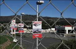 The closed Saturn of Colma sales lot sits empty on Sept. 30, in Colma, Calif. General Motors is closing its Saturn brand after negotiations with Penske Automotive to take over the brand fell apart.