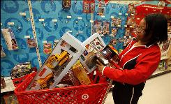 Last minute shopper Raedele Cubbage shops for Christmas gifts for her grandchildren at Target in the Lakewood Center mall in Lakewood, Calif.on Dec. 24.