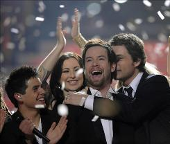 David Cook, center, is congratulated by fellow contestants David Archuleta, left, Carly Smithson and Michael Johns in 2008.