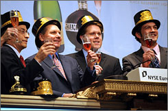 Champagne is raised as the last closing bell of the year rings at the New York Stock Exchange December 31, 2009 in New York.