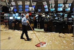 A janitor sweeps the trading floor of the New York Stock Exchange after trading ended December 31, 2009 in New York.