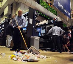 A janitor sweeps the floor of the New York Stock Exchange after trading ended December 31.