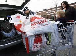 Shoppers load their car with purchases from a Kmart store in Somerville, Mass.