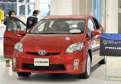 Toyota sold 208,876 gasoline-electric Prius vehicles in 2009.