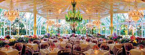 "Stained glass chandeliers hang from the ceiling of the ""Crystal Room"" of New York City's legendary Tavern on the Green. The restaurant closed its doors on New Year's Eve and its items are being sold at auction by Guernsey's Auction House."