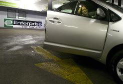 Jennifer Becker Mouhcine gets a Prius hybrid at an Enterprise Rent-A-Car in Chicago on Friday.