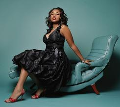 Oscar winner Jennifer Hudson models a Teri Jon dress in size 12.