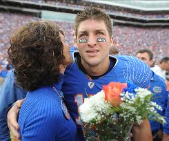Florida quarterback Tim Tebow embraces his mother, Pam, during a pre-game ceremony for graduating seniors on the Florida football team in 2009.