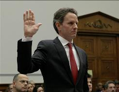 Treasury Secretary Timothy Geithner is sworn in on Capitol Hill.