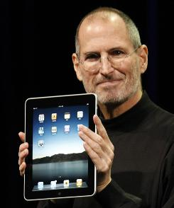 Apple CEO Steve Jobs shows off the iPad in San Francisco on Wednesday.