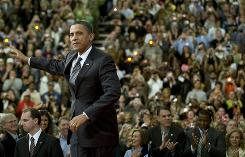 President Obama at a town hall meeting at the University of Tampa. In Tampa Thursday, he pitched his job creation plan and promoted $8 billiion in grants for high-speed rail projects.