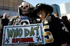Fans of the New Orleans Saints hold up a &quot;Who Dat Super Bowl&quot; sign in support of the Saints Jan. 24 outside the Louisiana Superdome, where the Saints won the NFC Championship Game. They will play in the Super Bowl. 