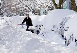 Mark Jordan digs out on Capitol Hill on Sunday. Two feet of snow is no barrier to work.