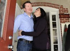 Marifran Manzo-Ritchie and her husband, Paul Ritchie, share a laugh in the foyer of their Phoenixville, Pa., home, which they plan to put on the market in the spring.
