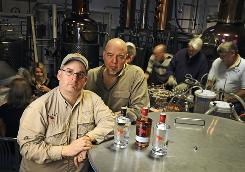 Don Poffenroth, left, and Kent Fleischmann converted their 401(k) funds to company stock to fund their start-up Dry Fly Distilling.
