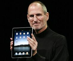 Apple CEO Steve Jobs holds the upcoming iPad, which won't support Flash video.