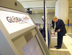 William Conley of Los Angeles uses the Global Entry kiosk after his arrival from Beijing.