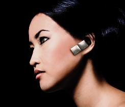 "A model wears the Ace version of the Jawbone Icon. Ace features a foxy-sounding female voice that says ""they can wait"" when you decline a call."