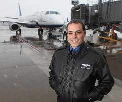JetBlue pilot Alex Scarcella, preparing for a flight Monday from Washington Dulles to Boston. Despite everything, he says he loves every takeoff and especially loves the view.