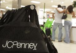 Shoppers look over jewelry at the J.C. Penney store in North Riverside, Ill.