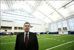 Domino's Pizza CEO David Brandon at a practice field at the University of Michigan in Ann Arbor. He'll become the school's athletic director in March.