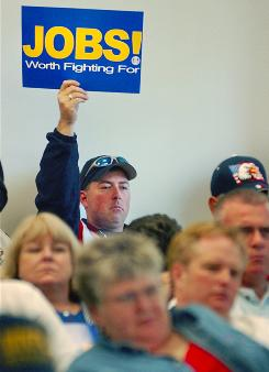 A Boeing worker at a 2003 meeting of a Washington state legislative committee shows his support of reforms in the state's unemployment system.
