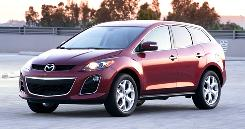 "The Mazda CX-7 turbo version pulls smoothly and evenly from idle to ""sorry, officer"" speeds."