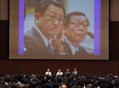 Akio Toyoda, president of Toyota Motor, Co.,left, accompanied by Yoshimi Inaba, chief executive officer and president of Toyota Motor North America, is seen on the screen during a Toyota's crisis meeting in Toyota city, central Japan, Friday, March 5, 2010.