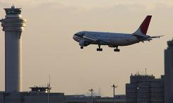 A JAL plane prepares to land at Haneda airport in Tokyo.