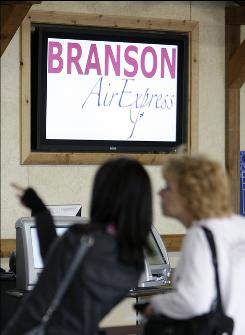 Travelers at Branson Airport wait to check in. The airport has started its own regional airline.