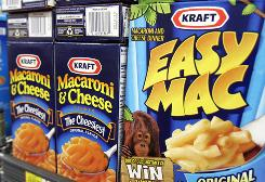 Kraft Foods Macaroni & Cheese dinners are seen on display at a market in Palo Alto, Calif. Kraft plans to cut salt in many of its products by an average of 10%.