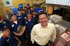 CEO J. Patrick Doyle with workers at Domino's Pizza headquarters in Ann Arbor, Mich. Doyle opened Domino's 300th outlet in India last week.