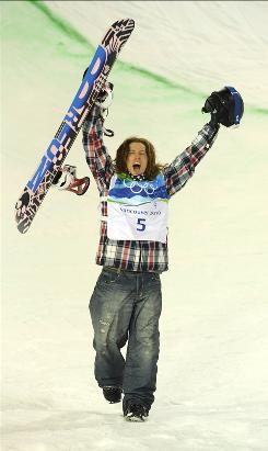 Snowboarder Shaun White celebrates at the Olympics. in Vancouver.