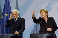 German Chancellor Angela Merkel and European Parliament President Jerzy Buzek of Poland address a joint press conference following talks in Berlin on March 22.