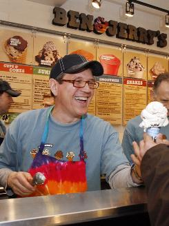 Jostein Solheim, the company's new CEO, serves a cone at the Ben & Jerry's ice cream scoop shop in Burlington, Vt., March 23, 2010.